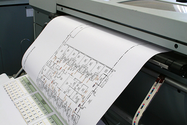 A large format plotter produces a blackline